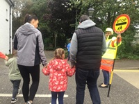 Crossing with Lollipop lady