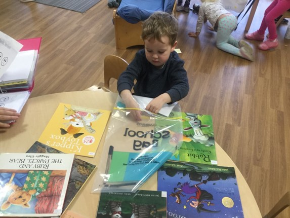 Child at table with books