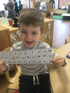 boy holding card with numbers