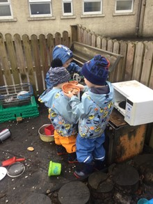 children playing outside at microwave