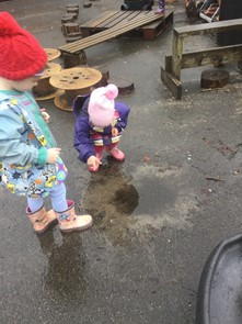 children playing at puddle